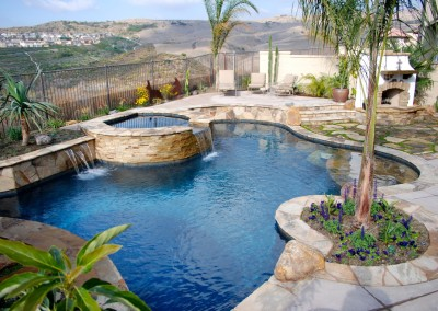 San Clemente Pool and Spa with fireplace by Aquanetic Pools