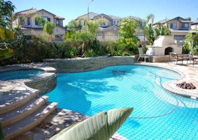 Pool and spa with fire pit in Laguna Niguel by Aqanetic Pools