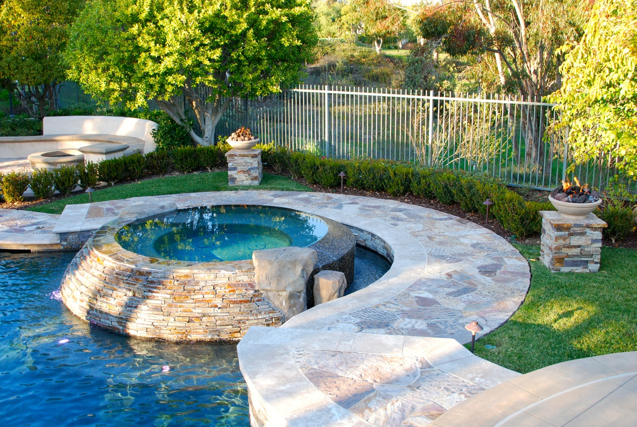 Pool And Spa With PebbleTec In Tustin By Aquanetic Pools