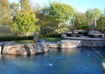 Pool and Spa with water feature by Aquanetic Pools