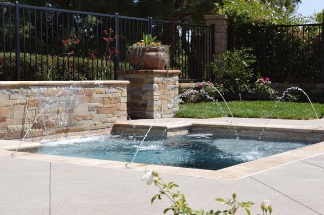 Custom, oversized spa with travertine coping, in Lake Forest