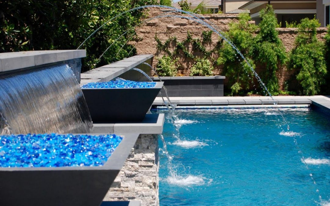 Aquanetic pools and spas custom waterfall pool water for Custom pool and spa