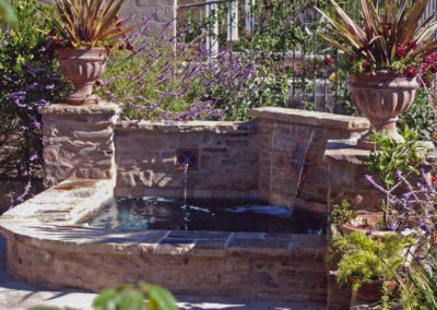 Raised Spa With Stone Water Feature