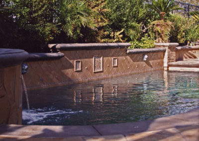 Pool With Raised Travertine Wall