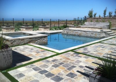 Pool & Spa With Raised Stone Decking