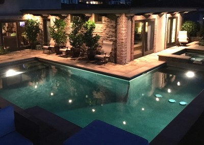 Traditional Pool With Travertine