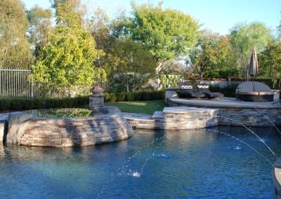Free Form Pool With Raised Walls & Stone Veneer
