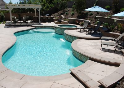 Free Form Pool With Scalloped Raised Walls