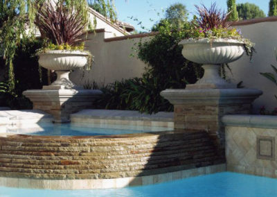 Stone Raised Spa With Formal Flower Pots